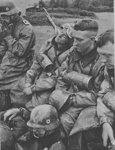 Waffen SS Totenkopf division reconnaissance motorcycle troops catch forty winks during a break of the advance on Moscow, 1941.