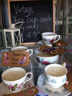 hand-made candles in vintage cups. Use the candle, keep the cup!