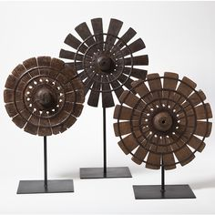 Fragment pieces from original old spinning wheels found in India are mounted on iron stands