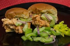 Slow Cooker Buffalo Chicken Sliders | Cook up some buffalo chicken in the slow cooker! This recipe for sliders is sure to become a family favorite slow cooker meal.