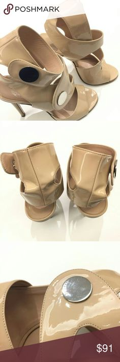 """Versace Nude Patent Leather Ankle-strap Sandals Versace Patent Leather Ankle-Strap Sandals  Size 37.5  Patent leather  Heel height approx 4.25""""  Open toe  Side snap closure  No storage accessories   *Please note that EU sizing may run small* Versace Shoes Sandals"""