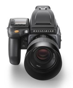 I WANT A HASSELBLAD SO BAD ITS INSANE BC WOW HOW BEAUTIFUL THEY MAKE DIGITAL ONES NOW BUT IT'D BE GREAT TO HAVE A FILM HASSELBLAD I AM STILL DOING RESEARCH ON HOW IT WORKS CAUSE THERE ARE A LOT OF PARTS, EBAY HAS A LOT OF USED ONES.