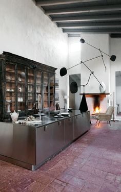 Wow! Antique and modern mix perfectly in a newly restored 15th century palace turned gallery/weekend home.