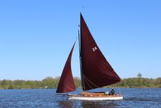 The yacht Pippa sailing on Wroxham Broad, Norfoilk