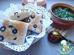 Постная хлебная лепешка с маслинами Предлагаю Вам попробовать постный хлеб с добавлением измельченных рисовых хлопьев, меда и маслин. Хлеб получился очень вкусный, мягкий, с медовой ноткой. Ингредиенты: Мука— 200 г Хлопья рисовые— 100 г Дрожжи— 2 ч. л. Сахар— 1 ч. л. Соль(мелкая) — 1 ч. л. Мед— 2 ч. л. Вода— 220 мл Масло оливковое(в тесто - 15 г; для смазывания формы и сбрызгивания хлеба - 15г) — 30 г Маслины— 70 г Соль(морская крупного помола) — 1 ч. л.