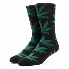 Take your feet above the clouds in the HUF Plantlife socks in the Black & Green color. Constructed from a soft cotton/polyester blend, these black crew socks feature an all over green weed silhouette print. The HUF Plantlife Black & Green socks will keep your feet so chill.