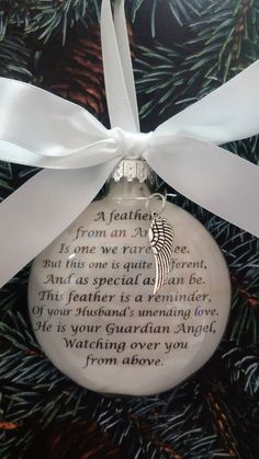 This is a beautiful an touching memorial ornament- perfect for Christmas or to display year round. The glass ornament is approx. 3 1/2 inches (80cm) in diam. and just over 1 inch (25cm) thick. It is topped with a white satin bow and you can choose to add a silver feather charm to hang around the neck of the ornament. The inside is filled with soft white feathers and the wording: A feather from an Angel, Is one we rarely see. But this one is quite different, And as special as can be. ...