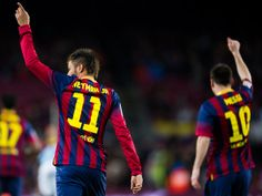 Neymar Santos Jr (L) and Lionel Messi of FC Barcelona celebrate after Neymar Santos Jr scored the opening goal during the La Liga match between FC Barcelona and RC Celta de Vigo at Camp Nou on March 26, 2014 in Barcelona, Catalonia.