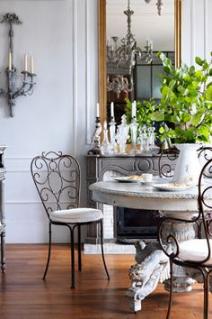 """Would you like your home to look a little more a la mode? Erin Swift, author of """"French Accents: At Home with Parisian Objects and Details"""" shares seven easy strategies. Cafe Chairs, Table And Chairs, Dining Chairs, Dining Table, Bistro Chairs, Rattan Chairs, Lounge Chairs, Dining Area, Dining Room"""