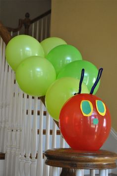 Very Hungry Caterpillar.  Balloon caterpillar down stair bannister.