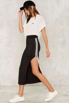 Sporty stripes and track-style suits are everywhere this season, which is why we are loving this unique twist on the trend that comes in the form of a sexy midi skirt. This side-striped piece is under Sporty Chic Outfits, Casual Skirt Outfits, Sporty Look, Sporty Style, Athleisure Outfits, Athleisure Fashion, Athleisure Trend, Star Fashion, Fashion Outfits