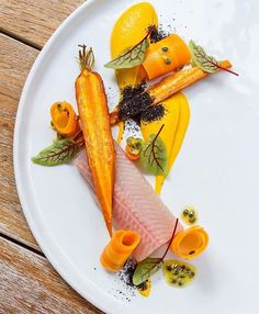 Sous vide trout with marinated, baked & puréed carrots, fresh passionfruit & squid ink crumble. ✅ By - Chef Gabor Feher at @escastudiorestaurant / By Laszlo Balkanyi ✅ #ChefsOfInstagram Join us www.ChefsOF.com