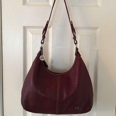 The Sak Oxblood Leather Shoulder Bag Silver hardware. Zip closure. Hang tag.  3 interior pockets (1 zips).  Good condition.  Leather bag.  Nylon bottom.  Measures: 14.75x3x8.25x14. The Sak Bags Shoulder Bags