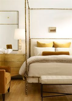 golden accents in a bedroom // All this needs is a beautiful blue can of paint applied to the walls. :)