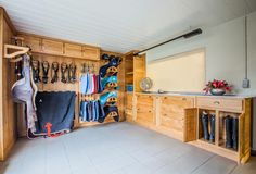Tack room in oak with a clear varnish