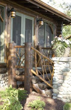 Love the branch detailing of the railing and on the windows - Bay Lake Lodge