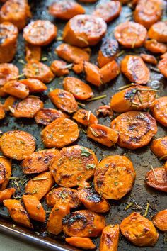 Apple cider glazed roasted carrots with pumpkin seeds and rosemary is an easy healthy side dish perfect for Thanksgiving and Christmas Braised Carrots, Glazed Carrots, Raw Pumpkin Seeds, Roasted Pumpkin Seeds, Roasted Apples, Cooked Apples, Paleo Side Dishes, Veggie Dishes, Whole Food Recipes