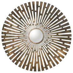 The starburst mirror is a classic whose shapes and finishes are constantly evolving. At more than 44 inches wide, this warm brass-plated piece could easily become a focal point. Tremeca Brass Starburst Mirror