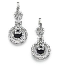 These are so Art Deco! Want!  Egyptian inspired flare to an art deco design with cubic zirconia accents and black enamel detail giving eye catching sparkle to these dramatic drop earrings.