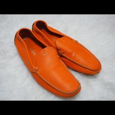 """Prada orange pebbled leather loafers 100% authentic. Used but in great condition. The leather still so nice, soft and vibrant looking as reflected in the pictures. Please take a close look at the pictures for signs of wear before purchase. NO RUDE/UNNECESSARY COMMENTS. NO LOWBALL OFFERS and make use of the """"offer"""" feature. Prada Shoes Flats & Loafers"""