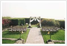 Enchanted Garden Malibu Wedding by Alchemy Fine Events www.alchemyfineevents.com at Stone Manor Intimate Malibu wedding ceremony with white birch arbor accented with crystal chandelier and sheer draped cheesecloth