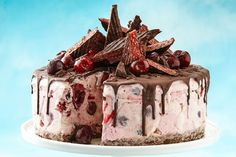 Cherry Ripe ice-cream cake This spectacular ice-cream dessert featuring chocolate, strawberries and Cherry Ripe only takes 20 minutes to prepare. Christmas Ice Cream Cake, Frozen Christmas, Christmas Lunch, Christmas Cooking, Christmas Desserts, Christmas Parties, Christmas Treats, Aussie Christmas, Holiday Treats