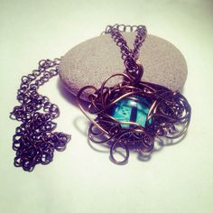 Wire work dragon/cats eye necklace  on Etsy, £15.00