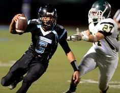 Description of . San Gorgonio High School quarterback Nate Meadors, left, runs the ball as Cajon High School's Jakob Gutierrez gives chase during a game on Friday, November 14, 2014 at San Gorgonio High School in San Bernardino, Ca. (Photo by Micah Escamilla/The Sun)