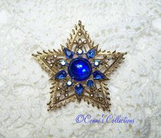 Do you collect Weiss Jewelry? Signed Weiss Vintage Rhinestone Brooch Blue by ConnisCollections