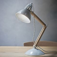This retro-style desk lamp combines a mid-century-shaped metal shade with an oak bifold arm to create a stylish modern lamp that will look great in both a contemporary and a Metal Table Lamps, Light Oak, Oak Table, Desk Lamp, Wood And Metal Table, Light Table, Table Lamp Wood, Retro Style Desk, Metal Wall Lamp