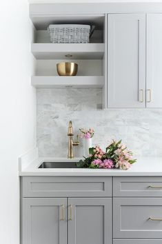 Laundry room designed with gray shaker cabinets, white quartz countertops and gray marble subway tiles for the win. Laundry room designed with gray shaker cabinets, white quartz countertops and gray marble subway tiles for the win. Grey Kitchen Cabinets, Shaker Cabinets, Laundry Cabinets, Gray Kitchen Backsplash, Marble Tile Backsplash, Backsplash Ideas, Tiles For Kitchen, Backsplashes With White Cabinets, Kitchen Subway Tiles