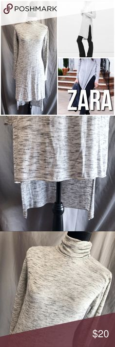 """Zara Long Knit Turtleneck Tunic Top M Awesome Tunic Top to wear with leggings or skinny jeans.  Long sleeve, turtleneck.  Split sides. Stretchy.  Color is an off white with black threads, gives an overall gray look. Approx measurements lying flat: chest 19, length at front 36"""" (longer in back) Small flaw, makeup mark near neck.  It's not seen when worn with the neck folded. Size M. B14. Please note,  The models in the cover photo or not wearing the actual top. They are pictured to show the…"""