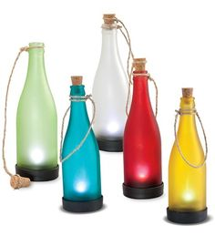 DIY light idea: solar lights, twine, a cork, and clear wine bottles painted with food coloring and elmers glue.