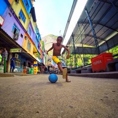 @Design Unlimited Bergman has some killer shots from his trip to Brazil.  This kid was in broken sandals with a flat ball. We started playing some 1v1 in the streets with my @Jonathan Nafarrete Nafarrete London World Futbol Project. Loved that he was 9 and trying to snake me! At the end, I left the ball with him  his friends. It's in better company now! // @GoPro #goprosoccer #racinha @Nike Football #riskeverything