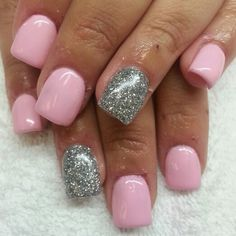 Acrylic nails with baby pink shellac and silver glitter.