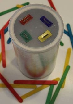 Simple preschool color matching activity that will also work on fine motor skills -- pushing colored popsicle sticks into an old coffee can! This activity not only develop cognitive skills, but and fine motor Motor Skills Activities, Montessori Activities, Infant Activities, Fine Motor Skills, Toddler Fine Motor Activities, Montessori Toddler, Indoor Activities, Toddler Learning, Preschool Learning