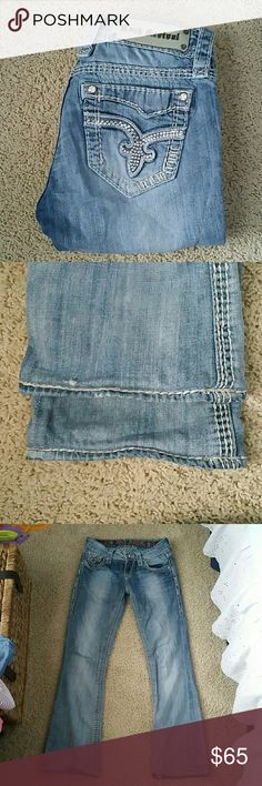 Rock Revival Jeans Jewel accents on pockets and button on front..  Size 25 Vivian boot cut Inseam is the 28 inches Rise is 7 inches 98% cotton  2% elastin Rock Revival Jeans Boot Cut