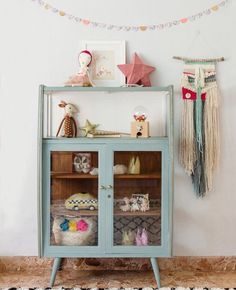 gorgeous vintage cabinet perfect for organizing kids stuff