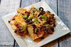 A tasty treat perfect for sharing!  Top your Nachos with Green Pepper, Onions, Cheese and Lindsay Olives
