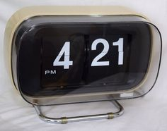 Vintage Copal 801 Flip Clock Tan Great for an End Table, Desktop, bookshelf etc Large Digits/Numbers Can be wall mounted on a wall or tabletop as the stand is removable. This clock works and keeps time. There are a few scratches & scuffs, the most prominent being on the lower right hand corner of the lens. Scratches through the the COPAL label and a scuff around the same corner, in about the center of the corner. There is dust inside the lens. **We have added security stickers to the...