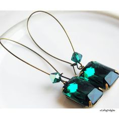 "These fabulous earrings are vintage 50's Swarovski green rhinestones that I hand set in antiqued brass settings, with large antique brass kidney ear wires and embellished with a beautiful Czech glass fire polished beads. These stones are really beautiful!!     This color is a rich forest green (green with a blue tinge, almost a teal).    Brides: I can easily make up a matching set of these for your bridesmaids. Contact me for more info.     The stones measure 18mm x 13mm (approx 1/2"" x…"