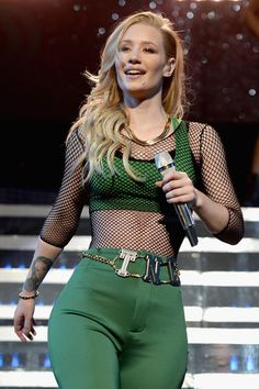 Iggy Azalea performs onstage during Y100's Jingle Ball 2014 at BB&T Center on December 21, 2014 in Miami, FL.