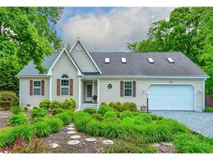 Charming exterior with lush gardens at this home for sale close to Bethany Beach DE - 104 S Newport Dr, Dagsboro DE