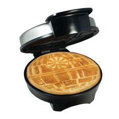 """This officially-licensedStar Wars Death Star waffle maker from the folks at Think Geek mightawaken the Force within you. We can add this to our 14 Star Wars Breakfast Ideas.  Here are the details for this fantastic waffle maker: > Produces a 7"""" diameter round waffle with two sections > Non-stick cooking plates duplicate the design on both sides > Indicators light up when iron is on and when it is at correct temperature > Non-skid rubber fee"""