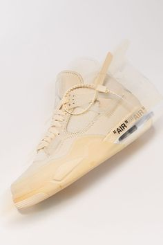 """Few sneakers have had a more interesting life than the Off-White x Women's Air Jordan 4 """"Sail."""" The monochromatic colorway debuted as a sample shoe on display at Virgil Abloh's """"Figures of Speech"""" exhibit before receiving an official retail release."""