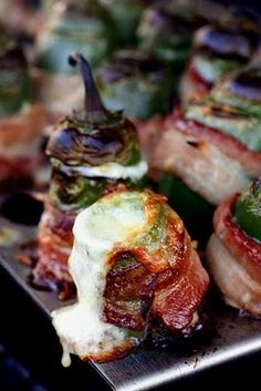 grilled bacon wrapped jalapeno peppers stuffed with cheese.
