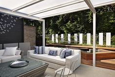 Outdoor living room with hot tub and swim pool | The Seattle Times