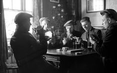 men drinking in pub