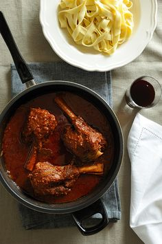 lamb shanks kokkinisto Greek for Red Sauce - (tomato base with onions cloves and cinnamon)