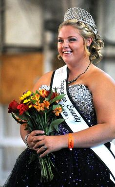 Lauren Sproul is crowned the 2015 Tuscarawas County Fair Queen as fair week kicks off Sunday night at the fairgrounds in Dover.